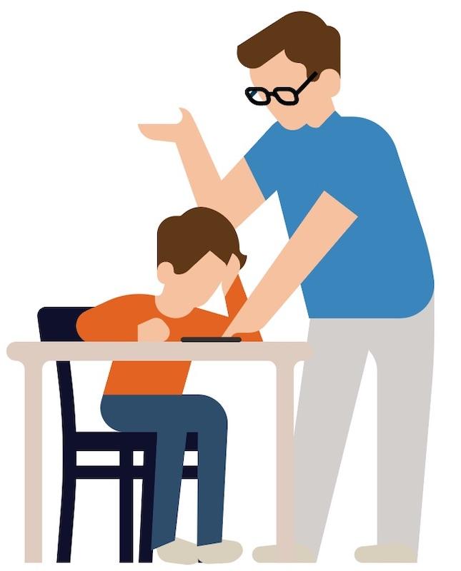 docent-legt-uit-aan-leerling-aan-bureau